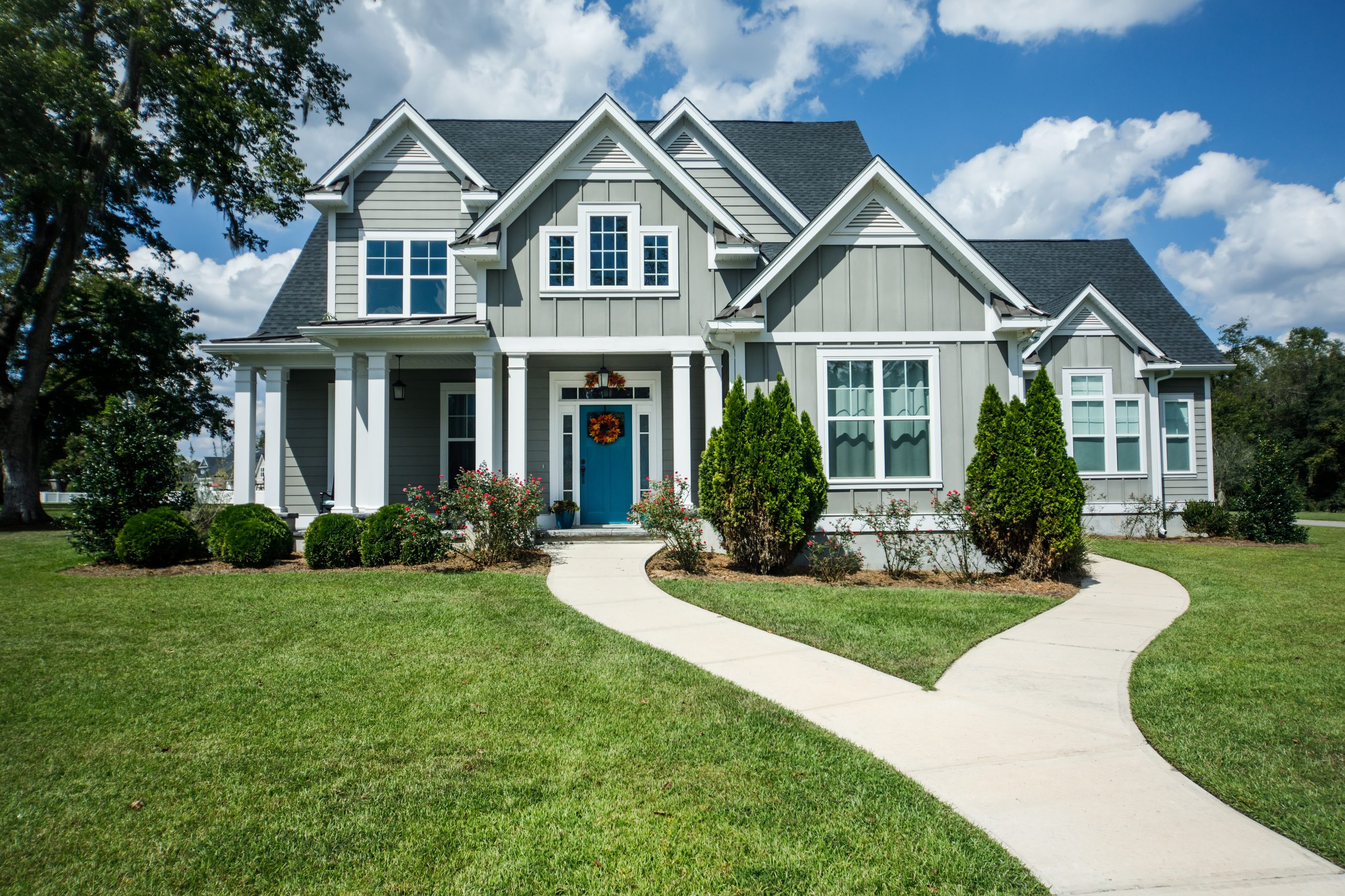 Gray New Construction Modern Cottage Home with Hardy Board Siding and Teal Door with Curb Appeal