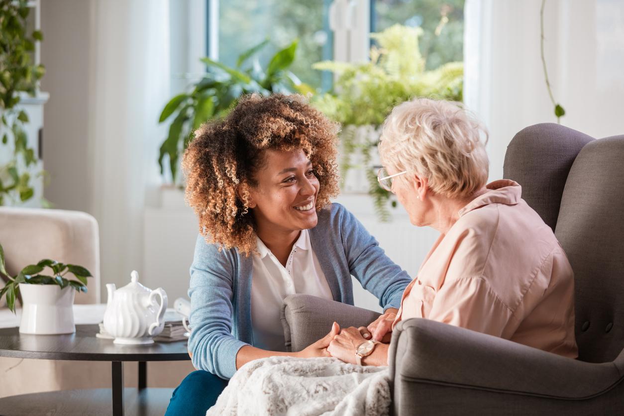 Nursing Home worker with elderly client